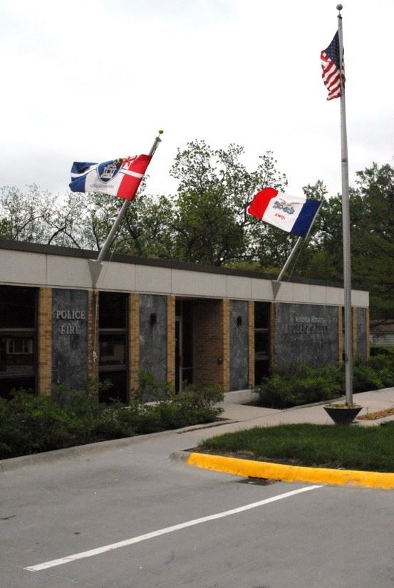 Exterior picture of Police Department building with flags
