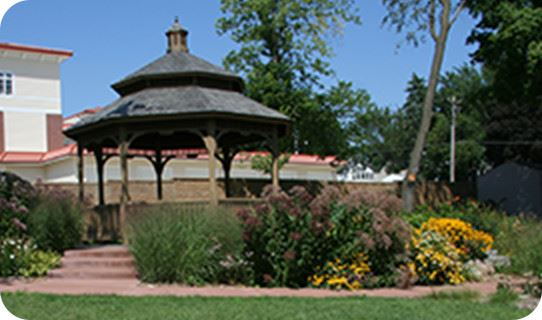A gazebo surrounded by flowers